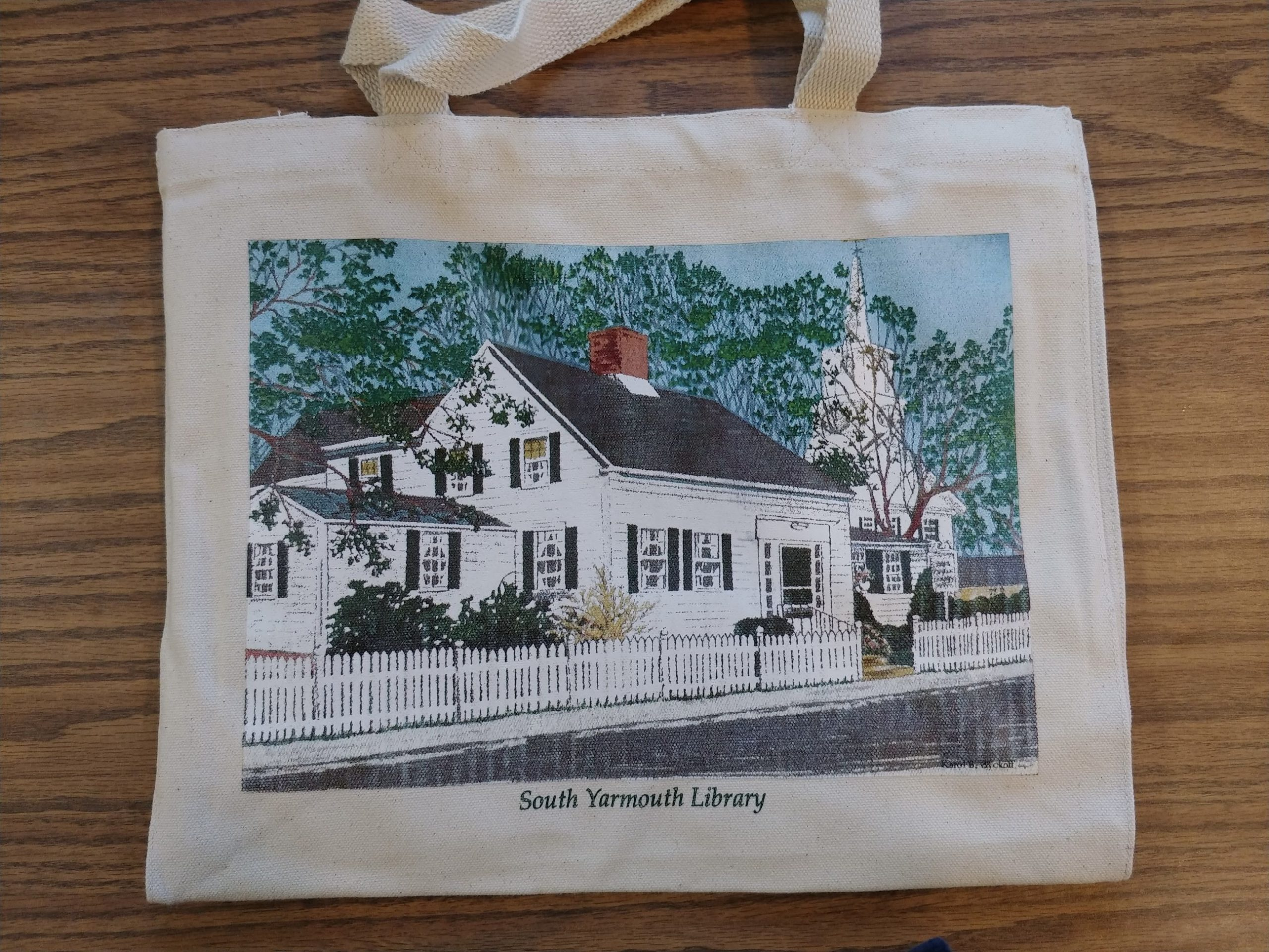 For a $15.00 contribution to the South Yarmouth Library Association, you can enjoy your own sturdy cotton book bag with a lovely illustration of the South Yarmouth Library by local artist Karol Wyckoff. Makes a great gift! Ask about it at the Library.